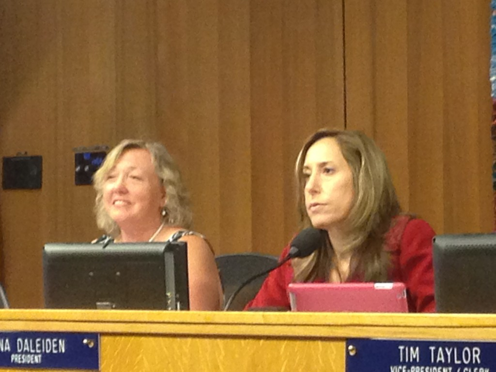 Board President Gina Daleiden (right) with Sheila Allen (left) listen to applicants talking about their credentials.