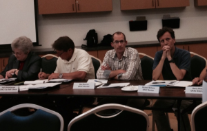 Richard McCann (far right) listens to a public comment on Thursday night