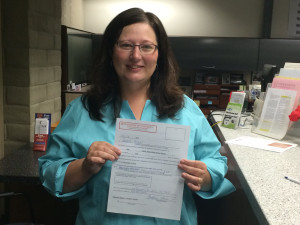 Barbara Archer holds up her paperwork after filing at the Yolo County Elections Office.  Her filing show she raised over $5000 for the reporting period ending June 30.