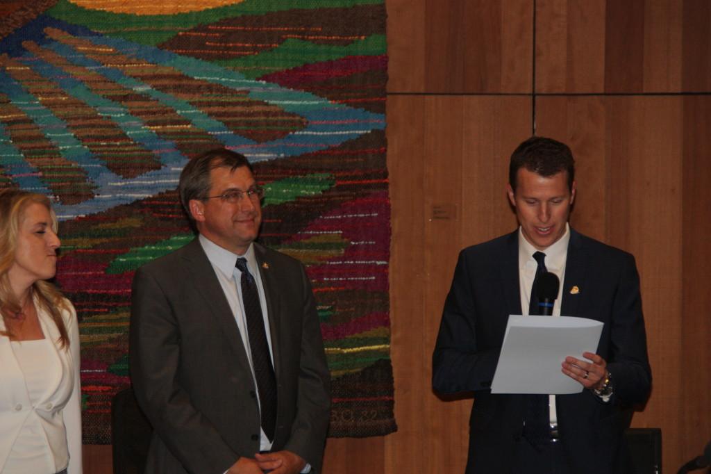 Dan Wolk reads from the proclamation to Joe Krovoza