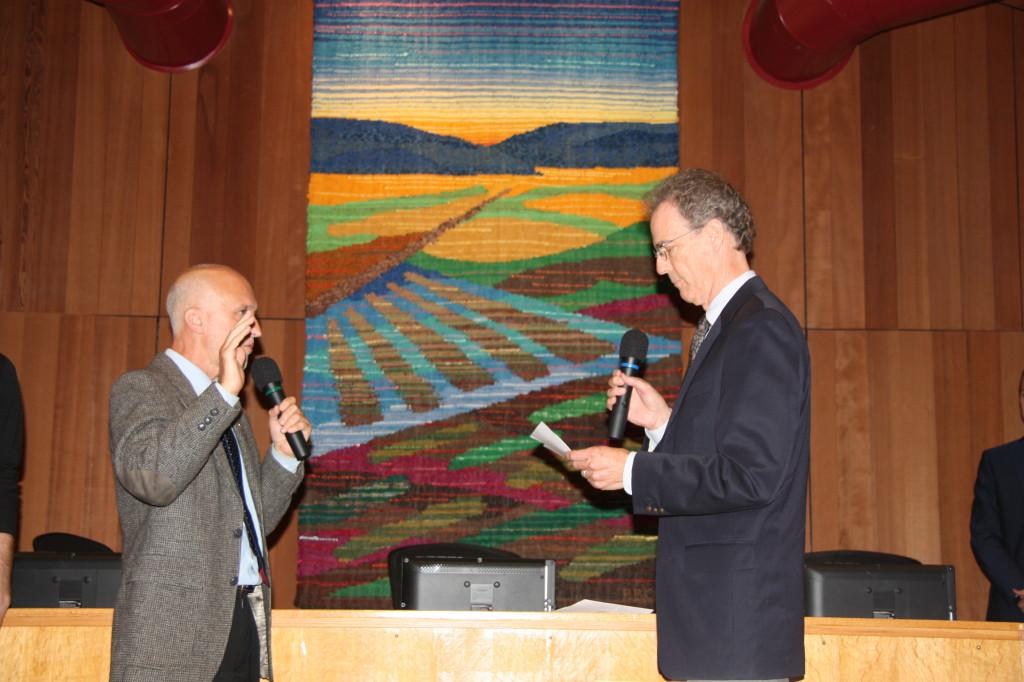 Chris Dunford, Retired former President of Freedom from Hunger swears in Mayor Pro Tem Robb Davis