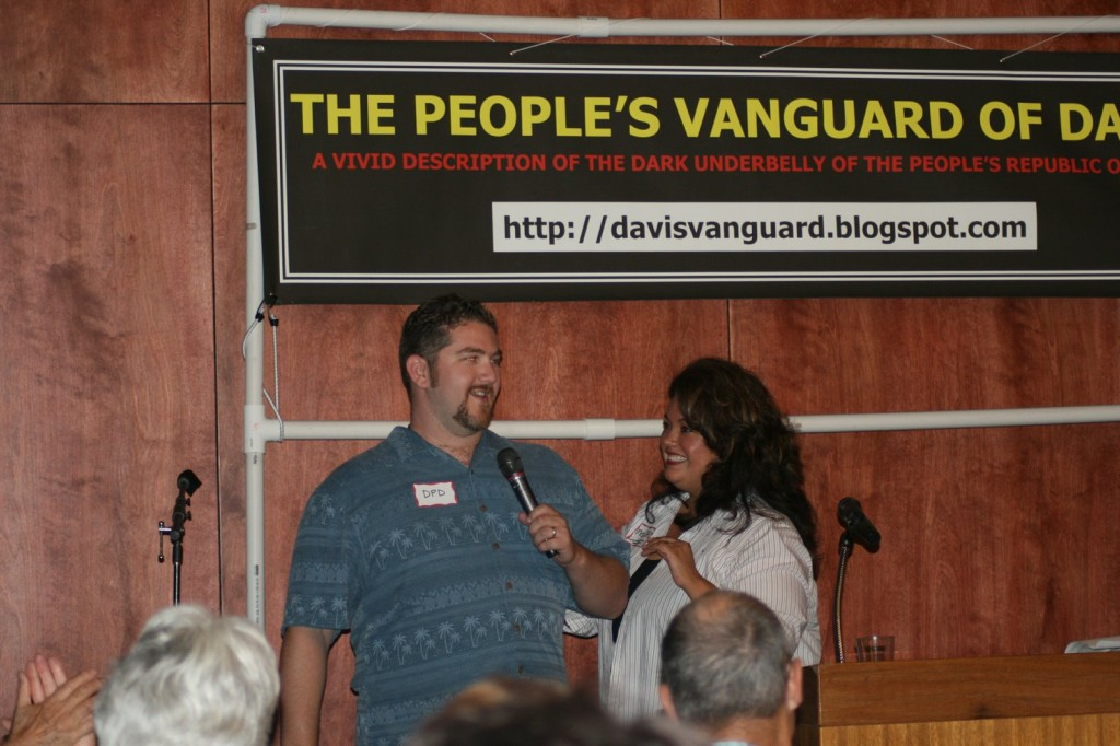 David Greenwald (DPD) speaks to the crowd in 2007 with wife Cecilia Escamilla Greenwald