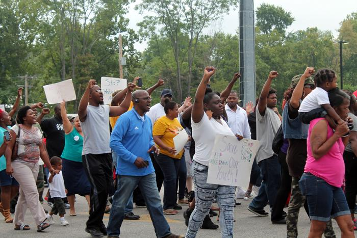 Protesters in Ferguson, Mo complain about the shooting of an unarmed black man