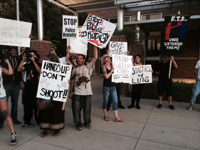 Protesters gather outside of the Woodland Police Station on Monday Night to protest the fatal shooting a 53 year old man