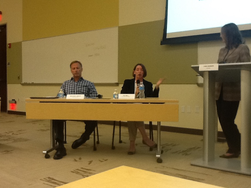 Michael Bisch (left) and Tia Will (center) about to respond to a question from moderator Chris Granger