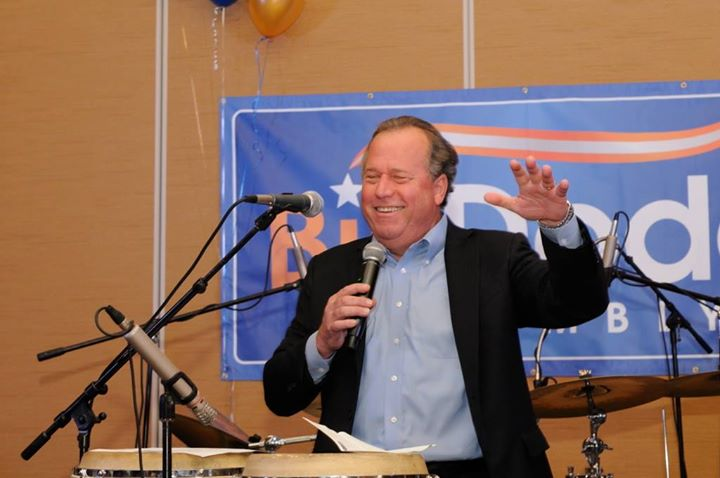 Bill Dodd celebrates victory in November 2014