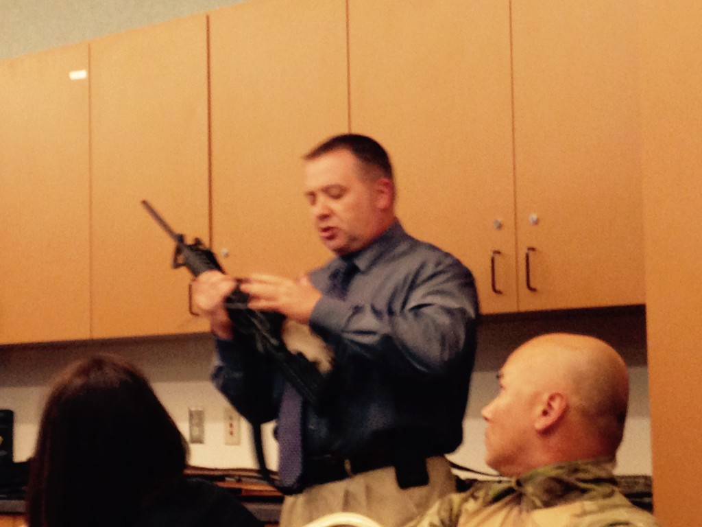 Lt. Paul Doroshov at November workshop illustrates weapons recovered by police in Davis