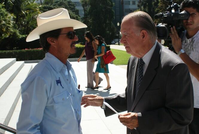 Cruz Reynoso talks to Santa Gutierrez, father of slain farm worker Luis Gutierrez, in Sacramento in 2010.