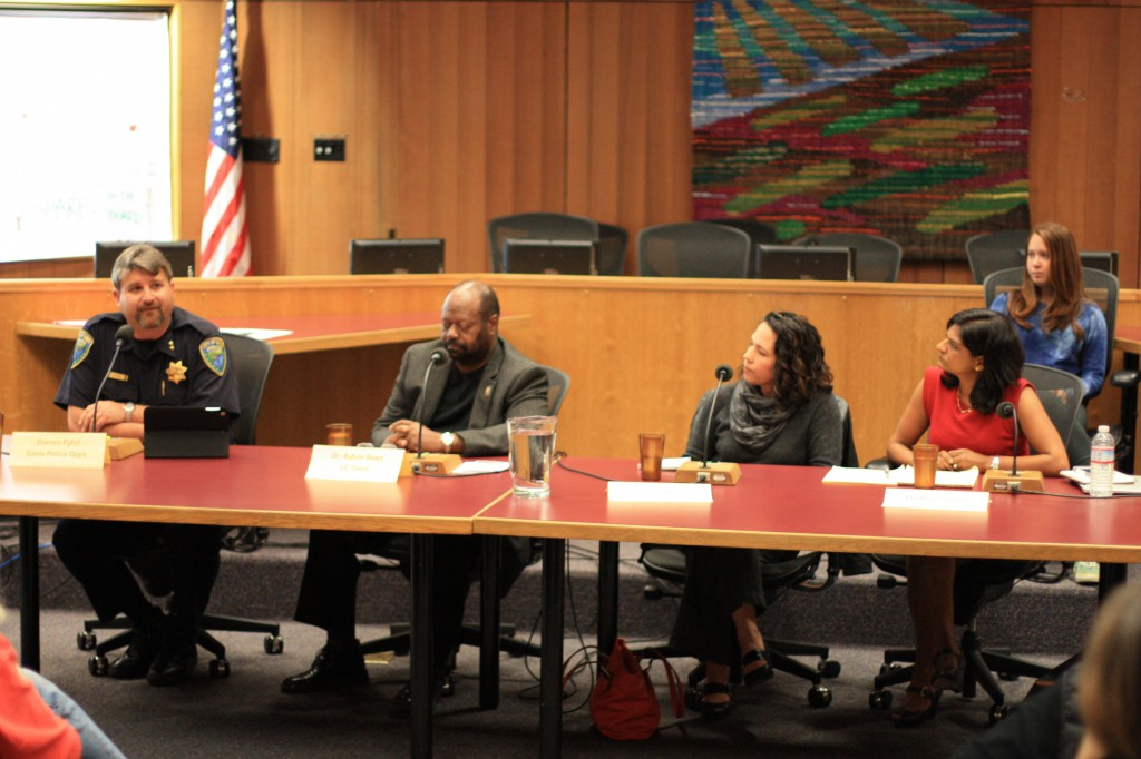 Davis Assistant Chief Darren Pytel speaks as panel (from left to right): Rahim Reed, Jennifer Mullen, and Madhavi Sunder look on