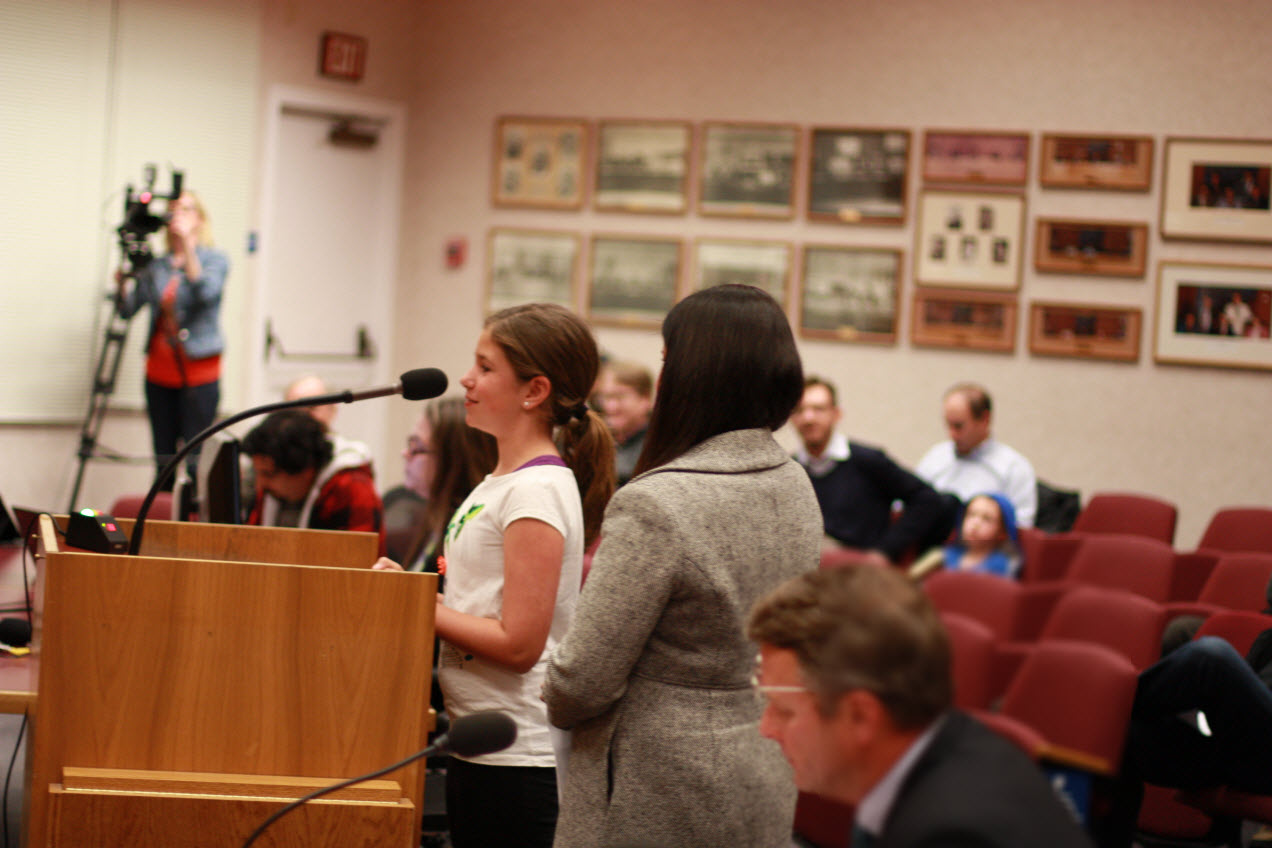 Jennifer Chapman steps back as her daughter briefly addresses council
