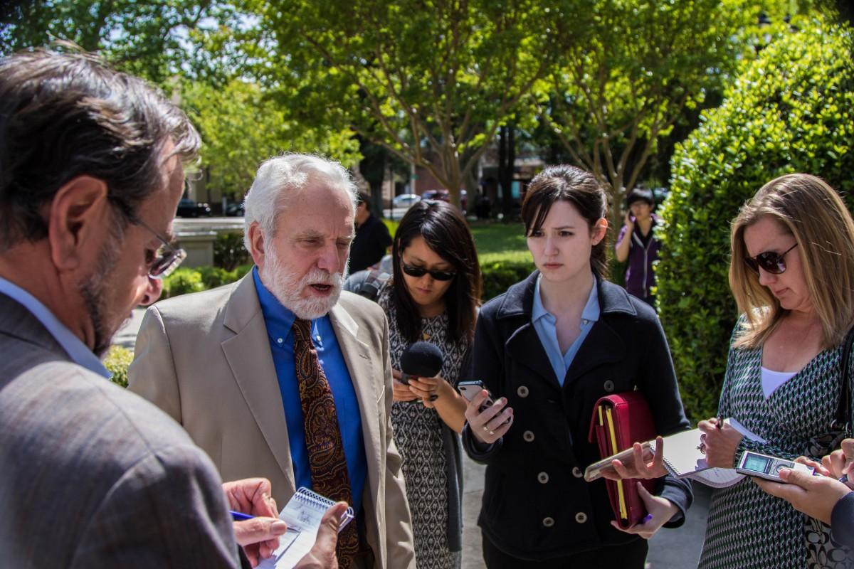 Dennis Reirdon surrounded by the press