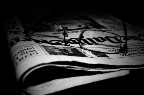 newspapers-and-glasses