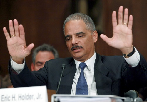 Former Attn. General Holder talked the talk on police reform, but practiced a bit differently  (Photo by Mark Wilson/Getty Images)