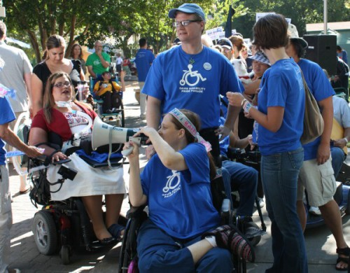 Natalie Wormeli speaks into a bullhorn at the 20th Anniversary of the Americans with Disabilities Act in 2010