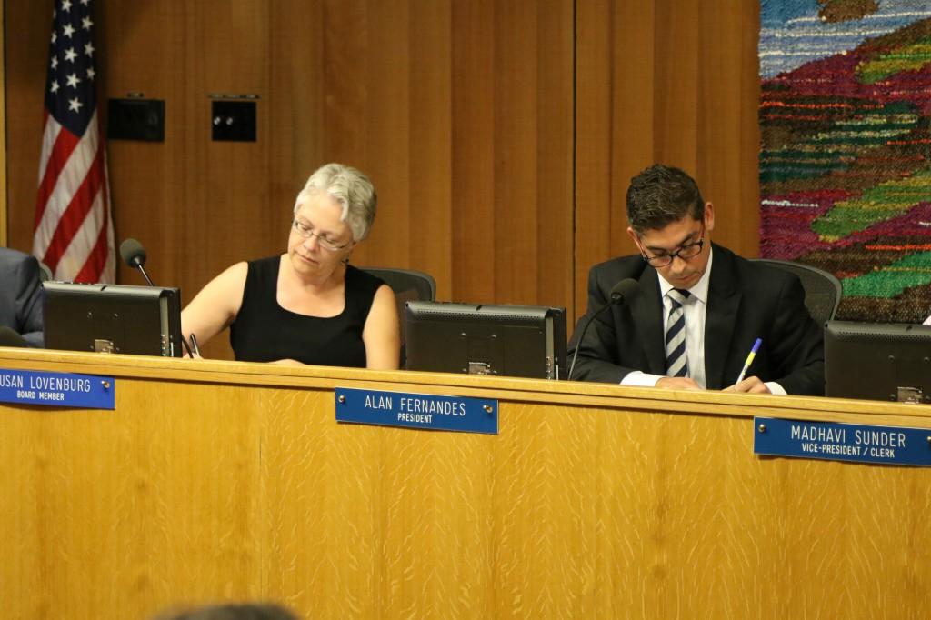 Alan Fernandes and Susan Lovenburg take notes