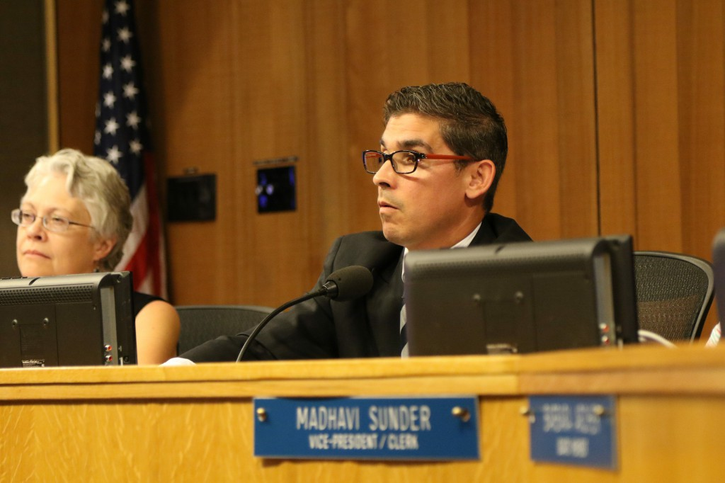 Board President Alan Fernandes listens to public comment