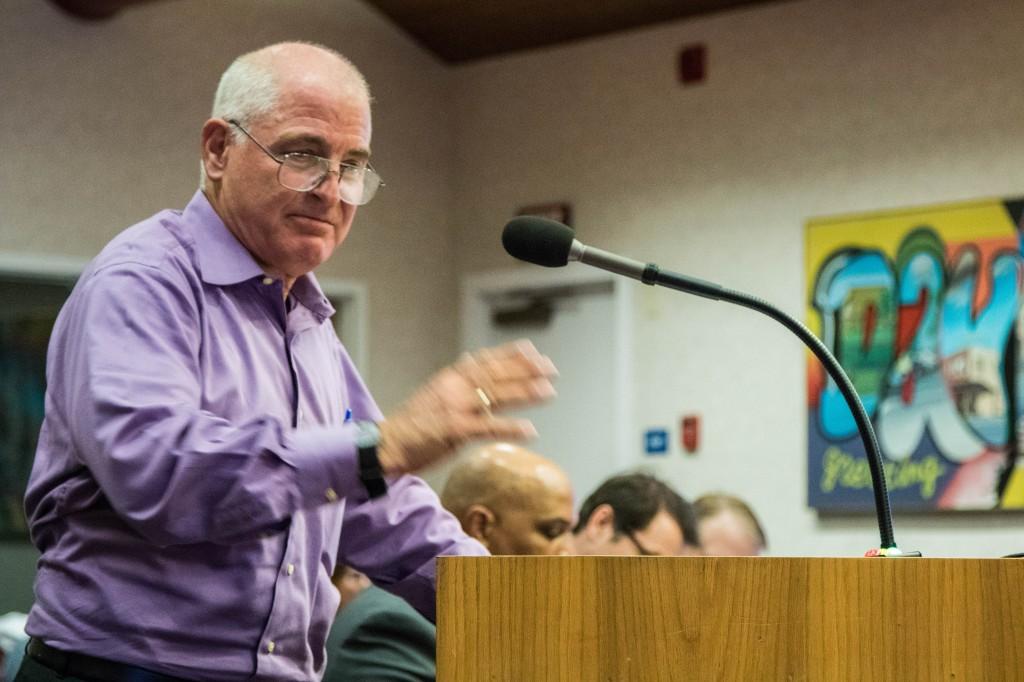 Alan Hirsch emphasizes a point during public comment
