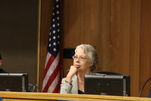 Susan Lovenburg listens to public comment on Thursday.