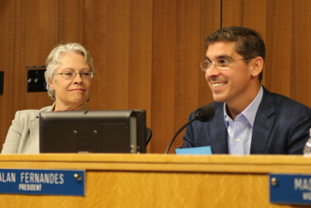 Alan Fernandes with Susan Lovenburg looking during the September AIM Discussion