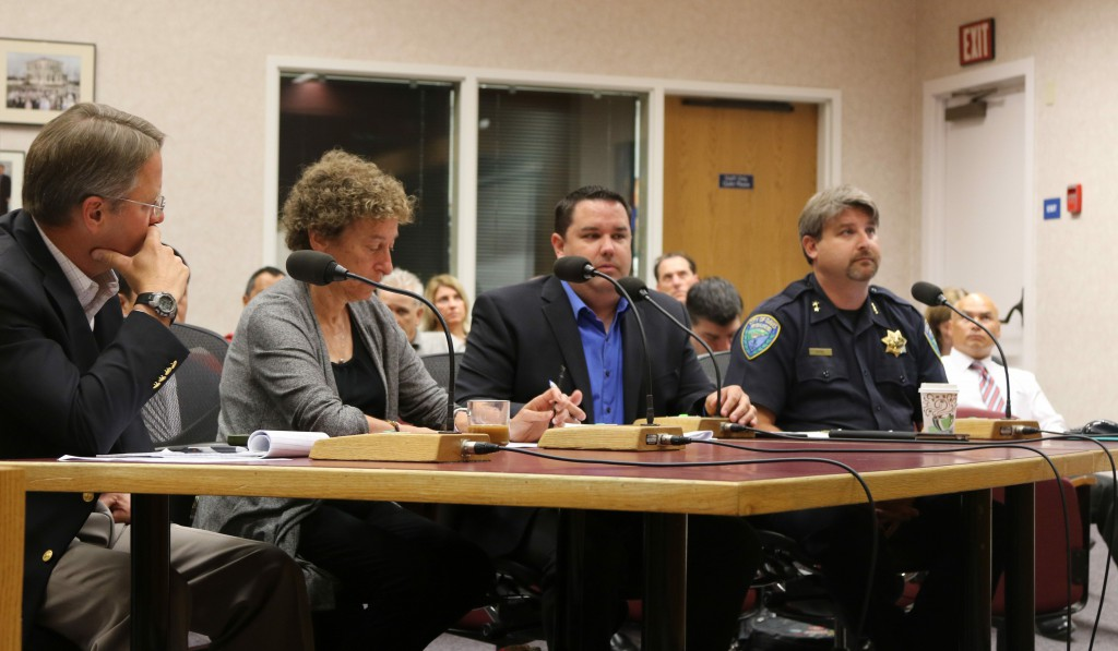 Community Development Director Mike Webb presents the ordinance with Assistant Police Chief Darren Pytel (far right), Harriet Steiner and Dirk Brazil