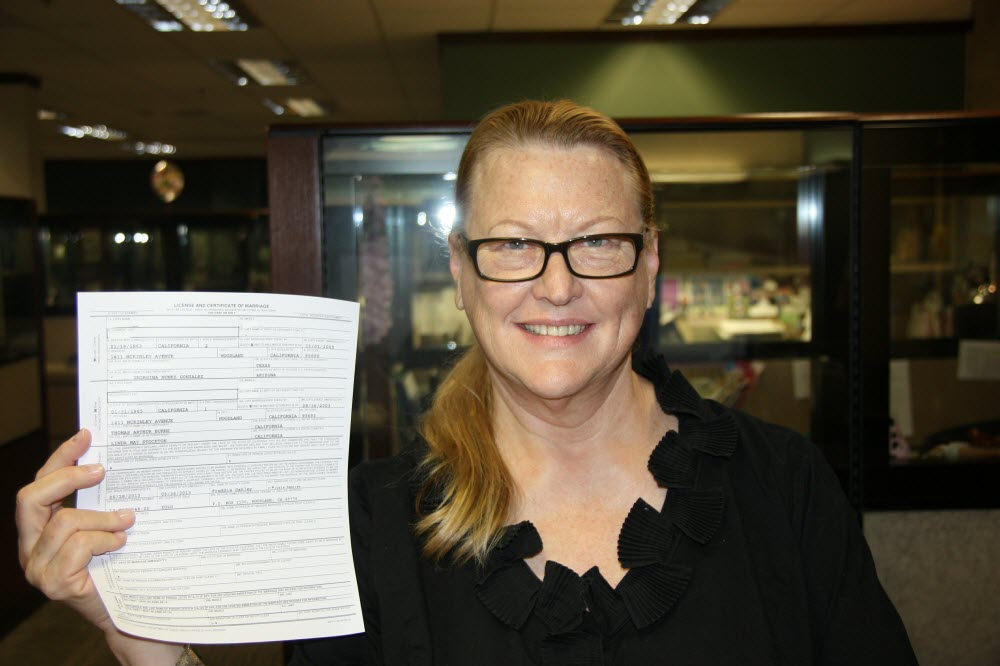 Freddie Oakley in 2013 holds up a marriage certificate