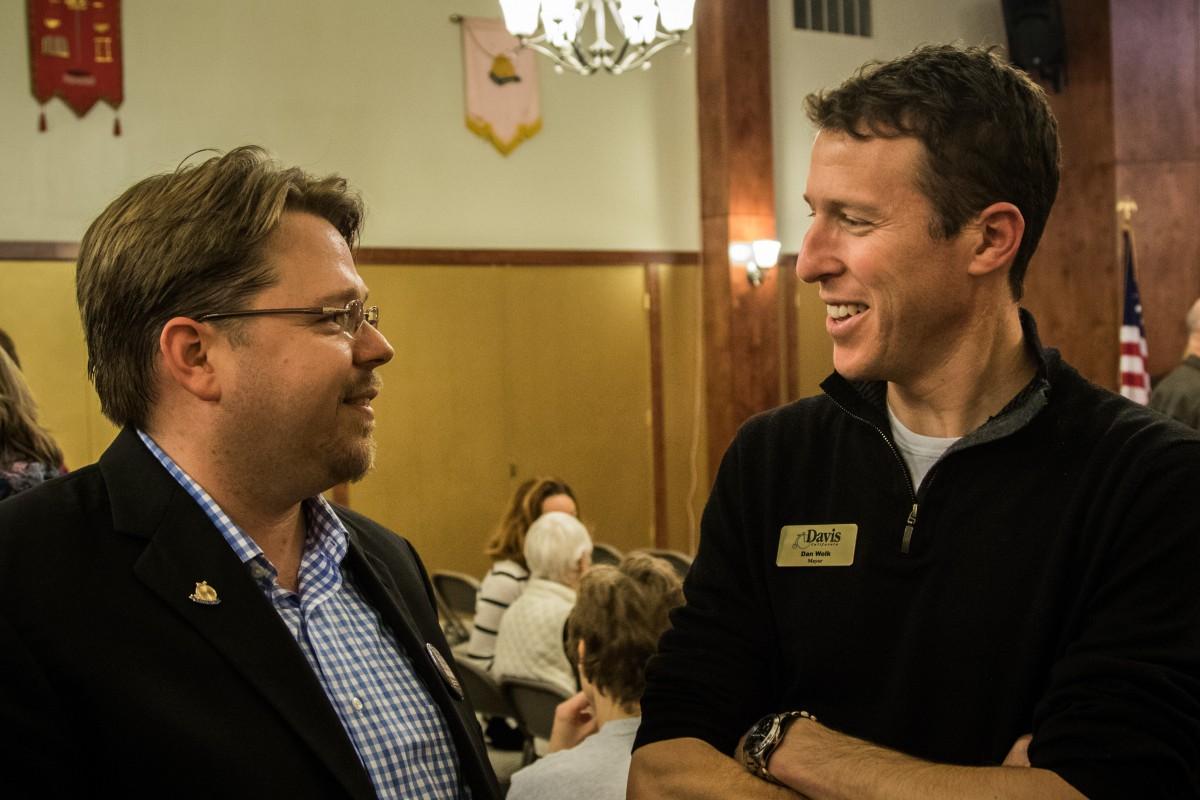 Lucas Frerichs talks with colleague, Davis Mayor Dan Wolk