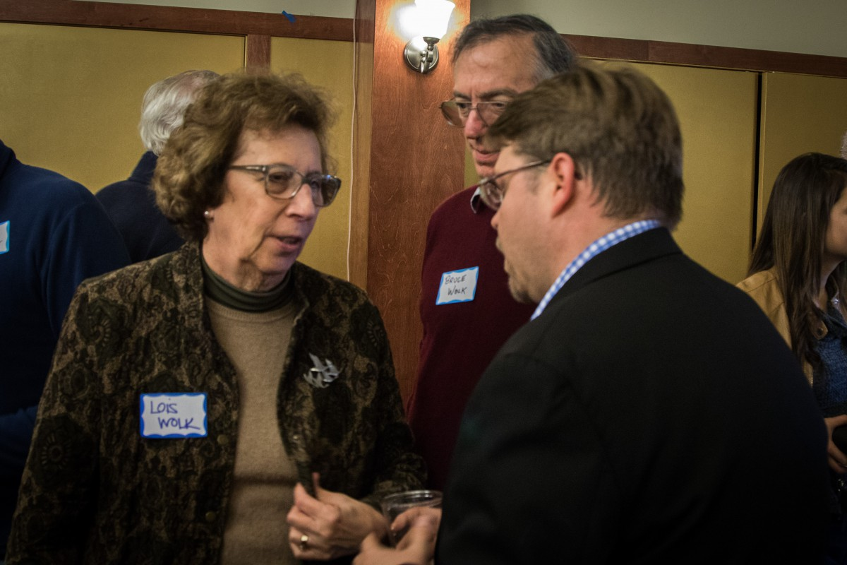 Senator Lois Wolk with husband Bruce Wolk (center) talks with Councilmember Frerichs