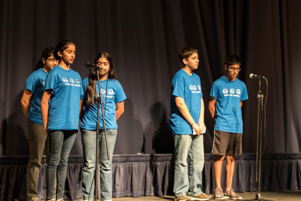 Harper Junior High students reading poetry