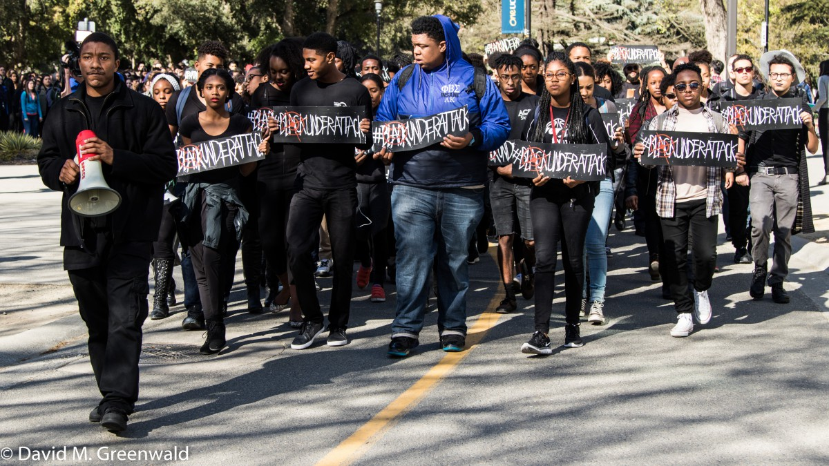 Students silently march through Campus from the Memorial Union to Mrak Hall