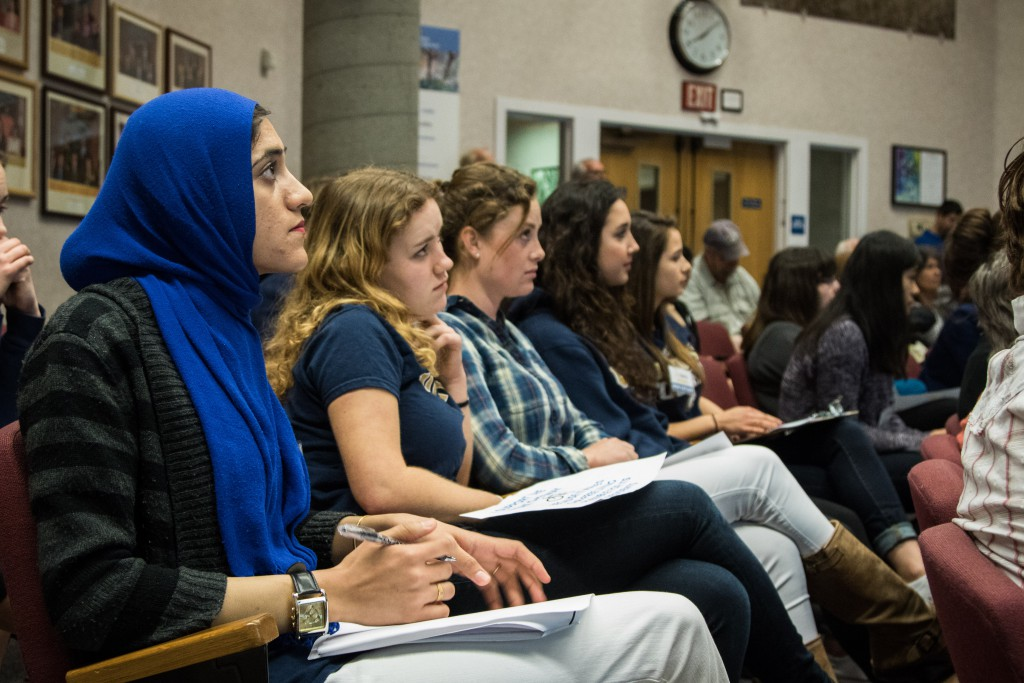 Students listen to public comments at Tuesday's meeting