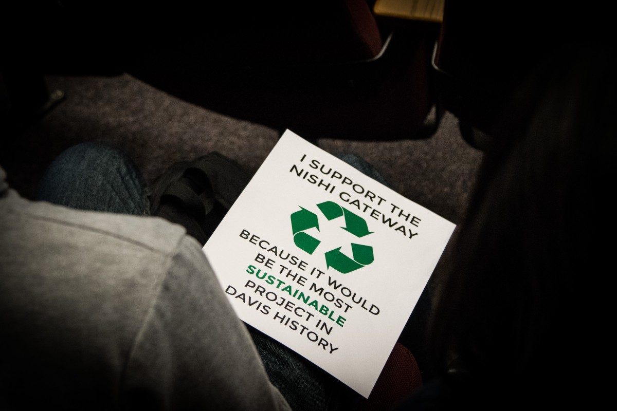A sign that students were holding on Tuesday night presents the project as highly sustainable