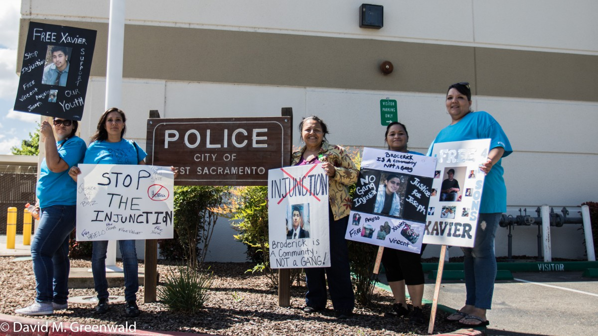The mothers of juveniles held in custody stand in from of the West Sac Police Station.