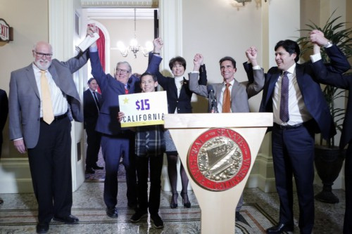 Senator Mark Leno and other sponsors celebrate the passage of SB 3/ Courtesy Photo