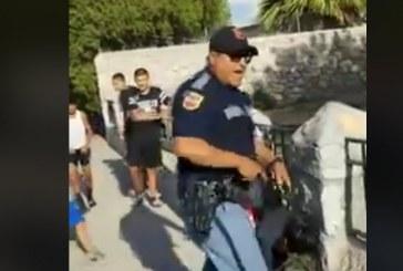 A Cop Yells at Kids and Draws His Gun
